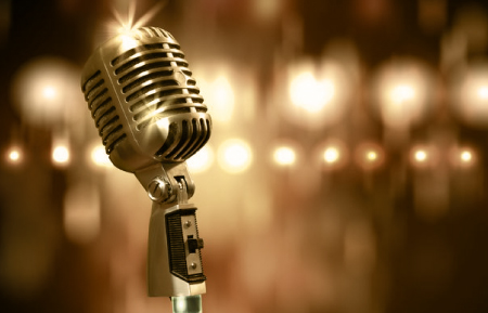 Photo of microphone and lights to represent podcast