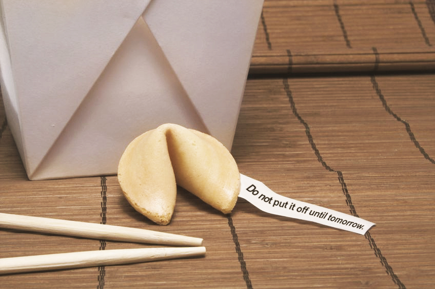 Fortune cookie with message that says: do not put it off until tomorrow