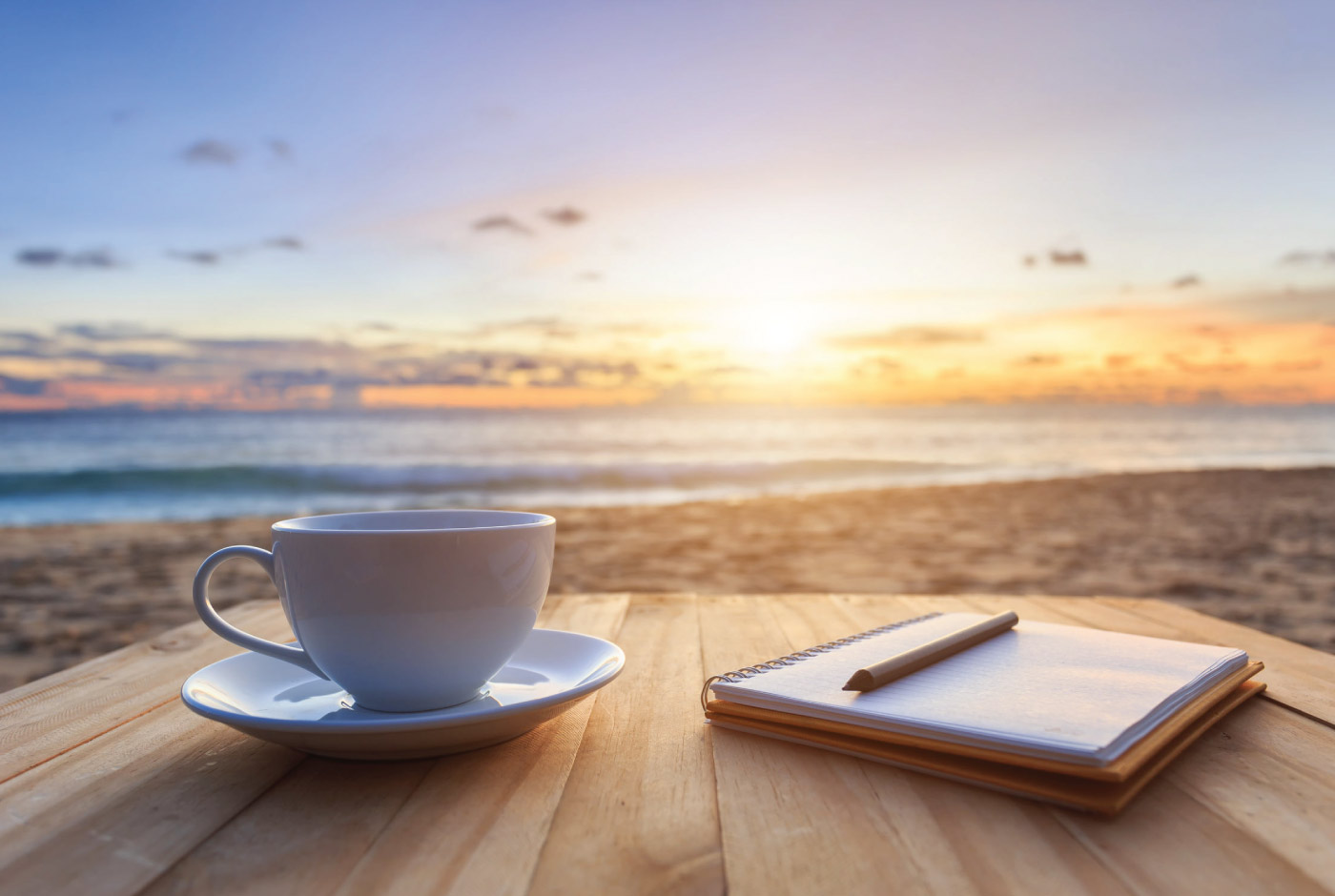 7 Minute Sales Minute Podcast - Season 11 - Episode 3 - Get On The Good Foot - Coffee and notepad on beach at sunrise